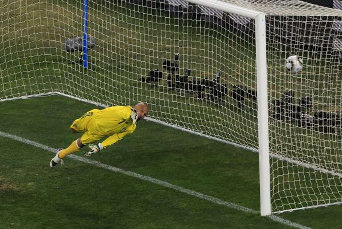 Mexico goalkeeper Oscar Perez fails to stop a goal by Argentina's Carlos Tevez, not visible, which put Argentina up 3-0.