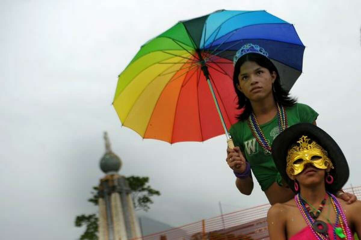 Revelers take part in the annual Gay Pride Parade in San Salvador, El Salvador, on June 26, 2010.