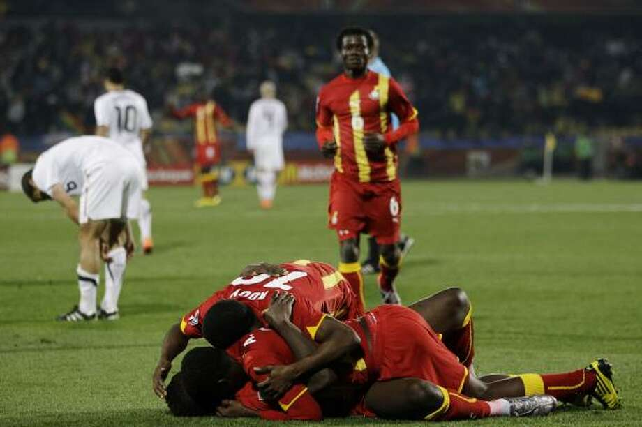 GHANA 2, UNITED STATES 1Ghana players celebrate following their extra-time win against the United States at Royal Bafokeng Stadium in Rustenburg. Ghana will play Uruguay in the quarterfinals. Photo: Guillermo Arias, AP