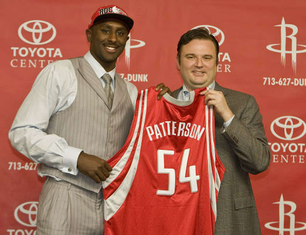 General manager Daryl Morey, right, made Kentucky forward Patrick Patterson the Rockets' first-round pick.