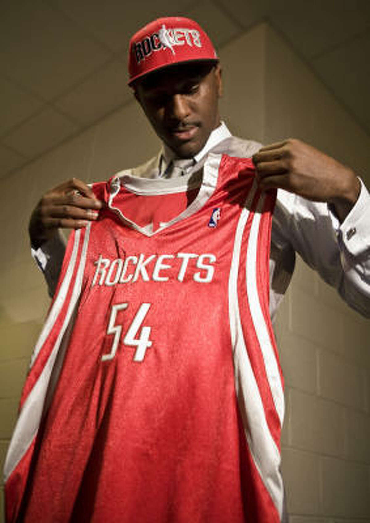 Patrick Patterson, who will wear No. 54, looks over his jersey.