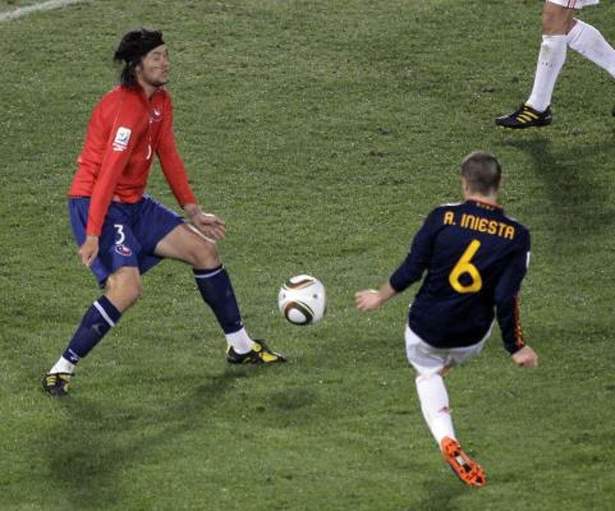 Spain's Andres Iniesta scores the second goal for La Furia past Chile's Waldo Ponce.