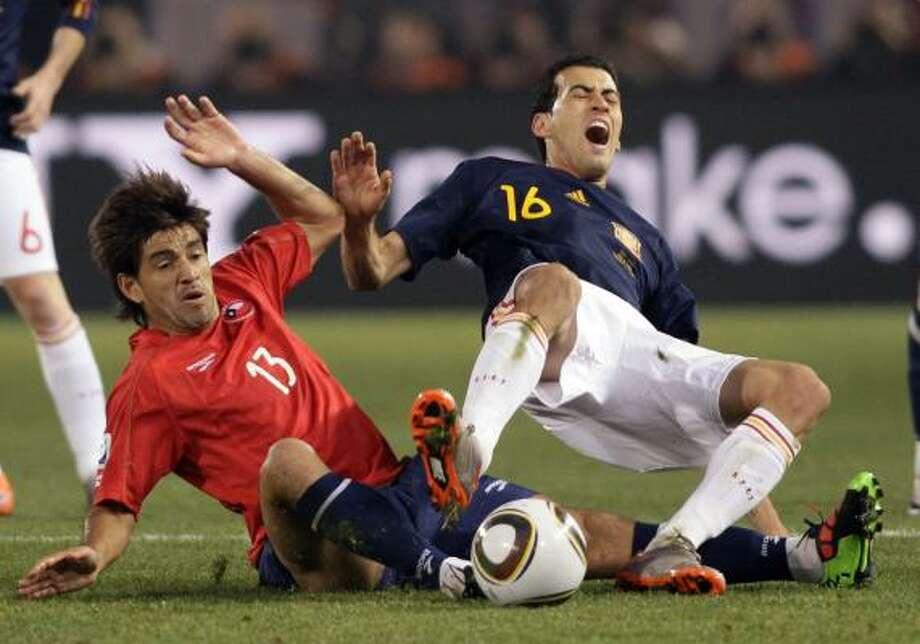 Player: Marco EstradaGame: Chile vs. SpainOffense: Clipped Spanish striker Fernando Torres from behind Photo: Ivan Sekretarev, AP
