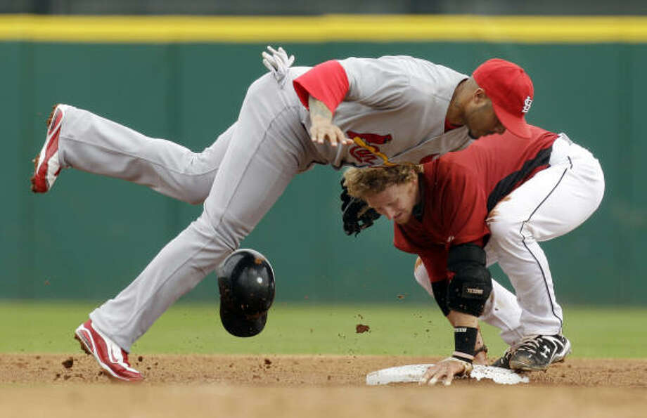 The Astros' J.R. Towles, right, beats the tag by St. Louis second baseman Felipe Lopez after hitting  a double Monday. Photo: Charlie Riedel, AP