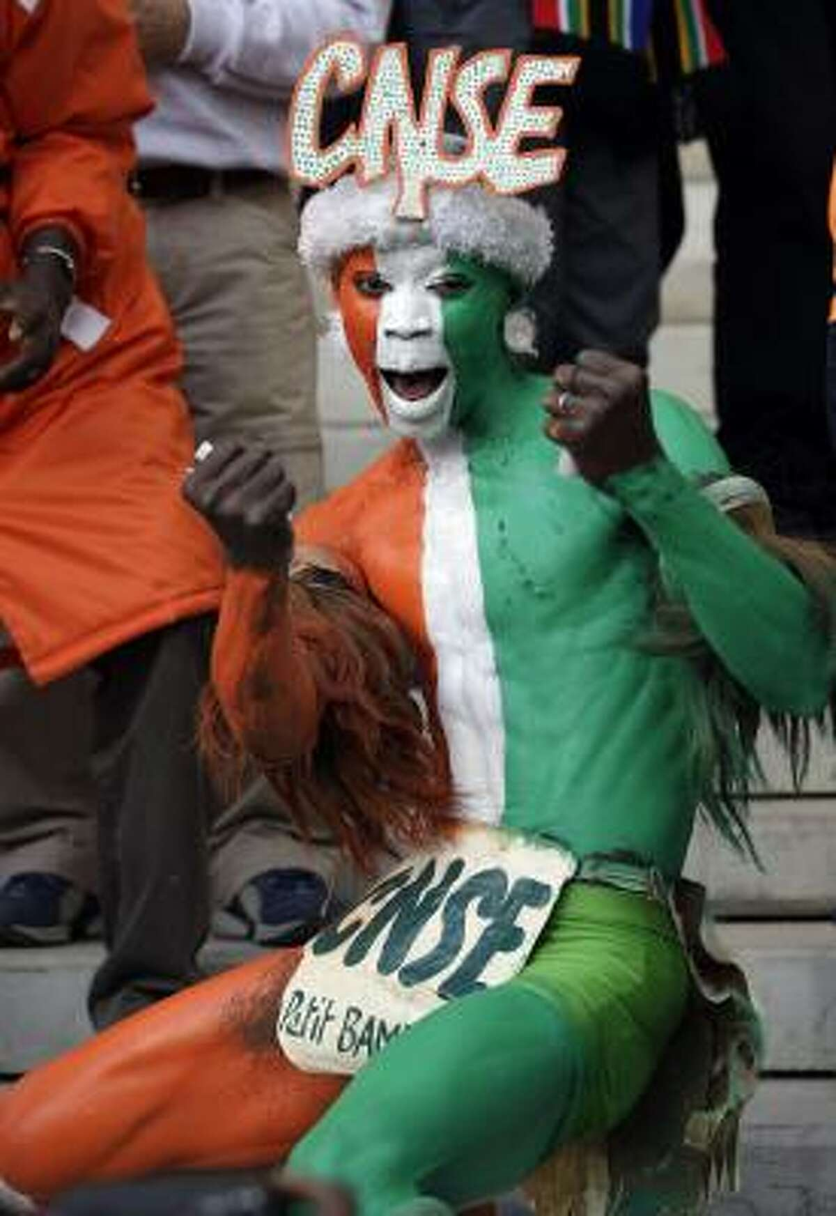 A fan of the Ivory Coast is pumped up for the match against North Korea.