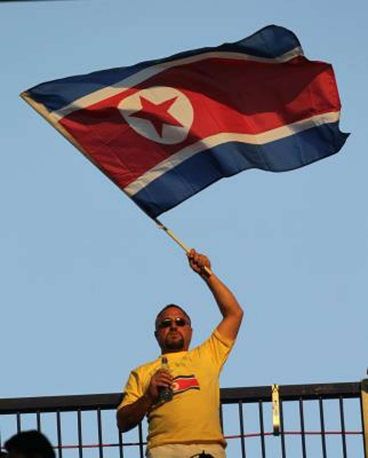 A man waves a North Korean flag during the World Cup group G soccer match between North Korea and Ivory Coast at Mbombela Stadium.