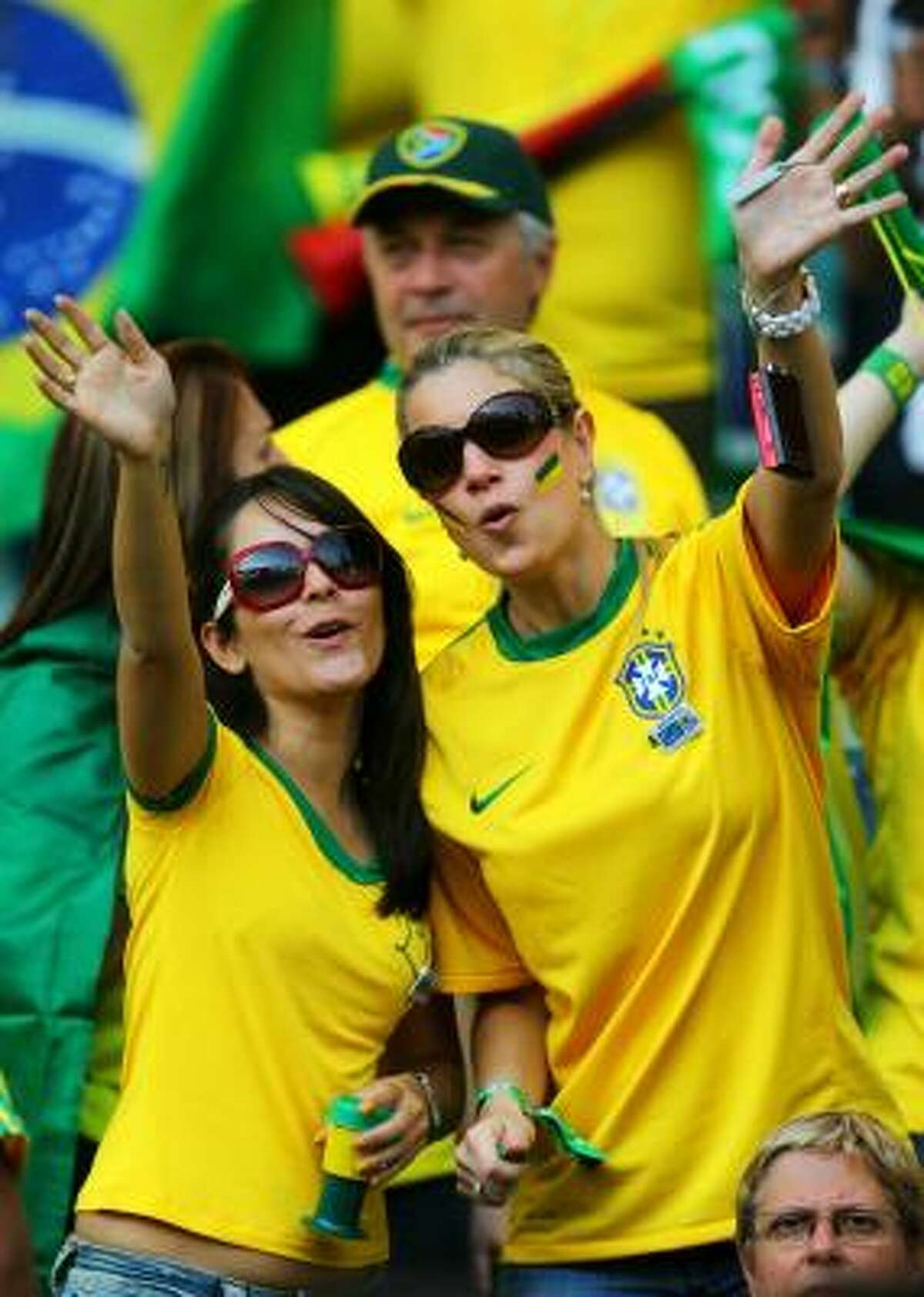 Brazil fans enjoy the atmosphere at the match against Portugal.