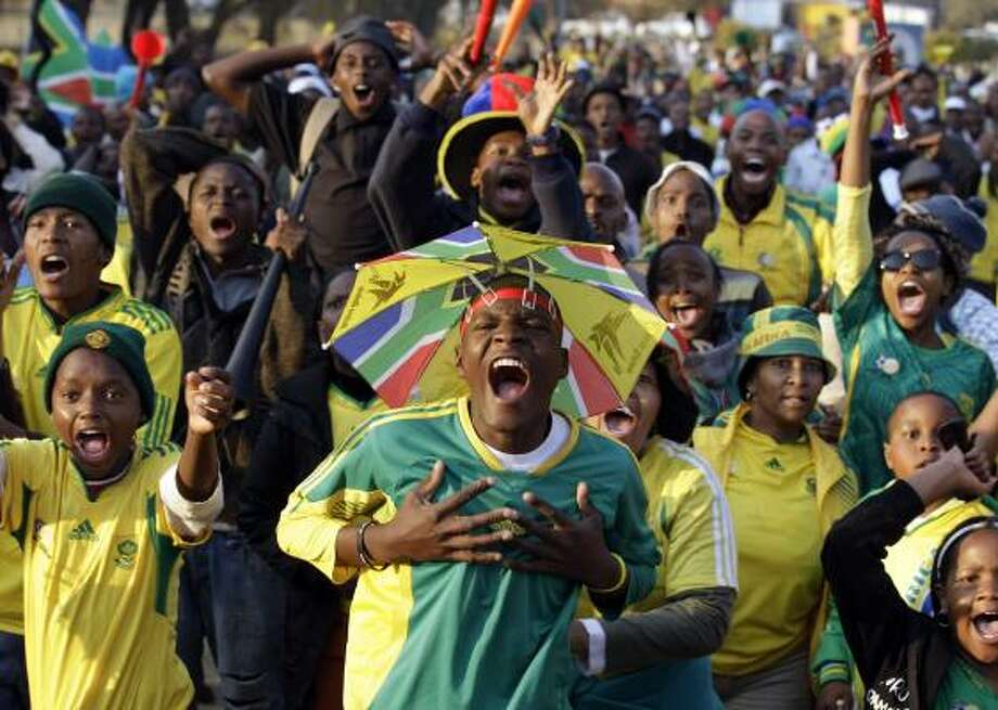 South Africa fans at a public viewing in Soweto react as their team scores on France. Photo: Frank Augstein, AP