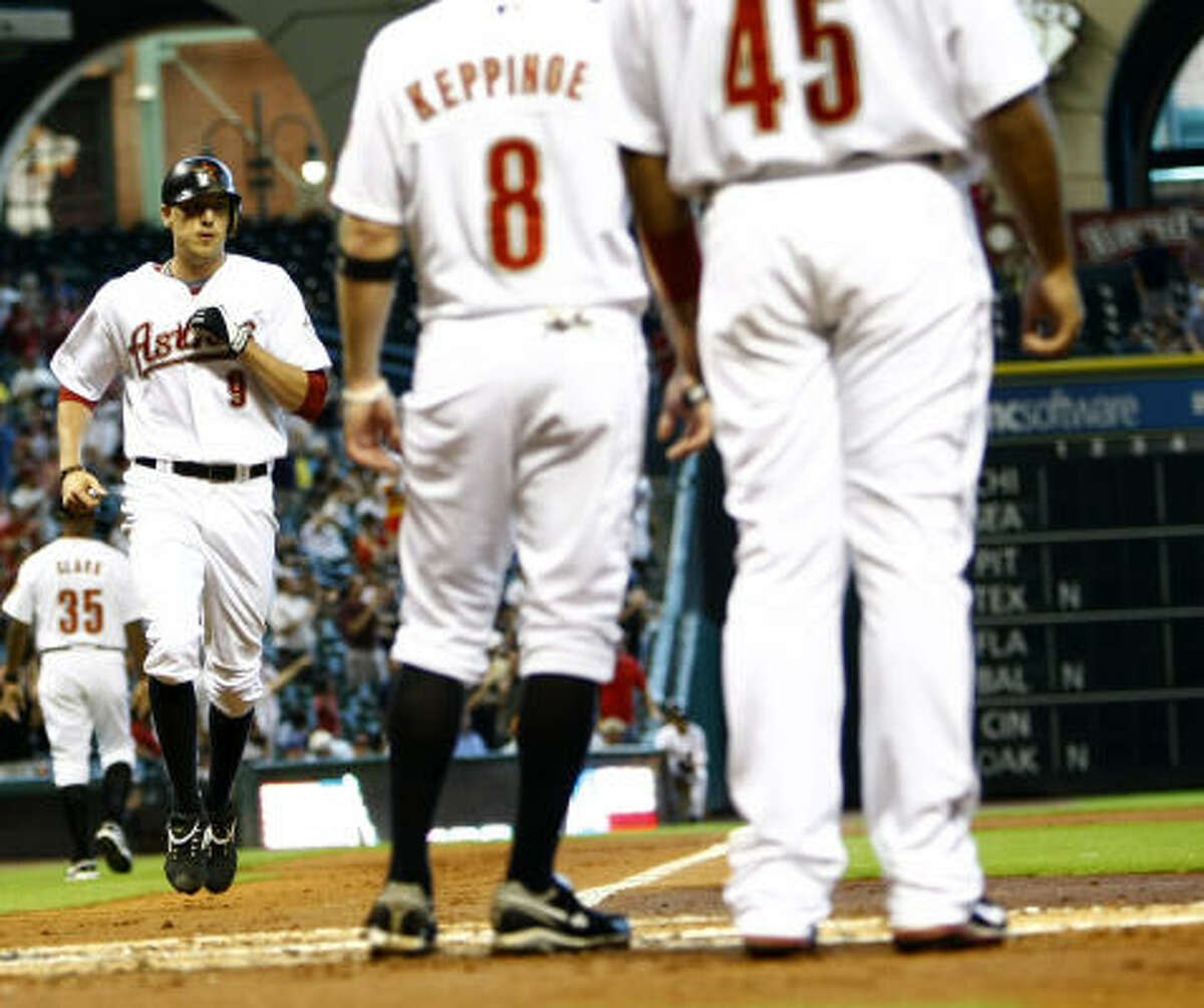 Astros Hunter Pence trots to home plate after his three-run home run during the first inning.