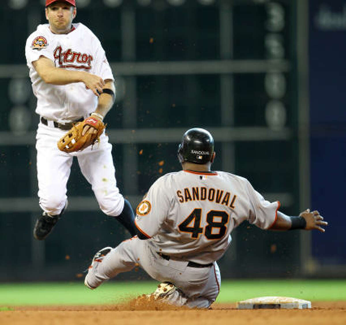 Astros' shortstop Jeff Keppinger tags out Pablo Sandoval at second base during the fifth inning.