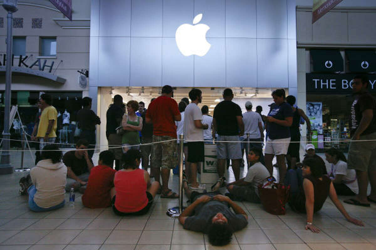 People wait in line for the chance to purchase a new Apple iPhone 4 at the Apple Store in the Memorial City Mall in Houston. Hundreds of people lined up in the mall with some camping out as early as 6:00 p.m the night before to purchase one of the 800 reserved phones at the store.