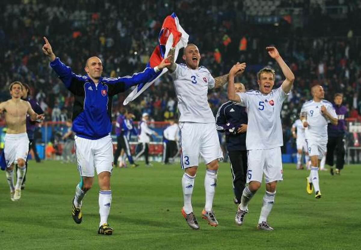 SLOVAKIA 3, ITALY 2 Robert Vittek, Martin Skrtel and Radoslav Zabavnik of Slovakia celebrate a victory that saw them through to the second round and eliminated defending champion Italy at Ellis Park Stadium in Johannesburg.