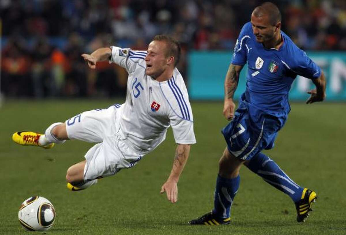 Slovakia's Miroslav Stoch, left, is tackled by Italy's Simone Pepe.