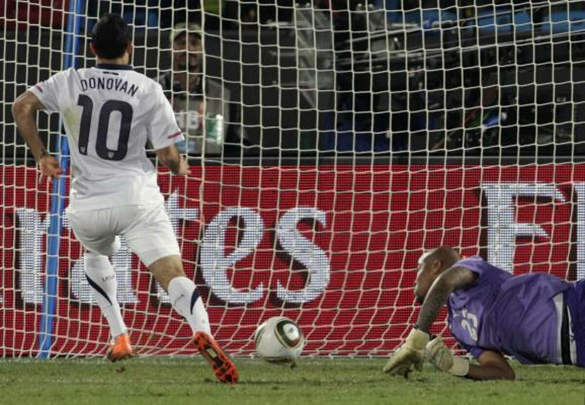 Landon Donovan's shot off a rebound beat Algeria goalkeeper Rais M'Bolhi and propelled the U.S. into the round of 16.