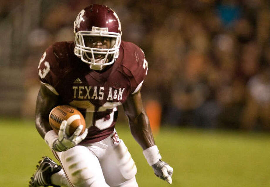 After rushing for 884 yards and 10 touchdowns last season as a freshman, Texas A&M's Christine Michael is a natural for a 1,000-yard season. Photo: Nick De La Torre, Chronicle