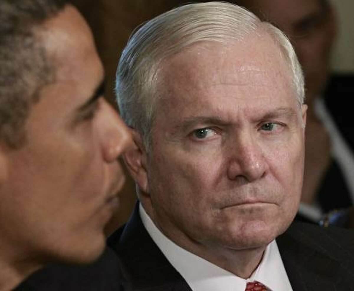 Secretary of Defense Robert Gates listens as President Obama tells reporters during a Cabinet meeting that he thinks Gen. Stanley A. McChrystal, the commander of Western forces in Afghanistan, used