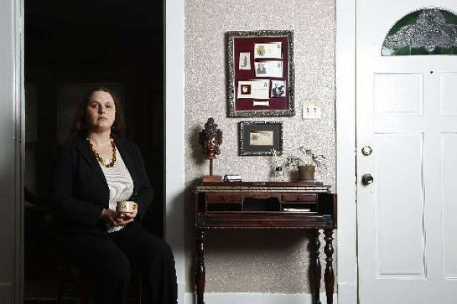 Cristan Williams holds a coffee cup from Cooper's Donuts in Los Angeles, where in the '50s one of the first transgender uprisings occurred. Williams, who transitioned from a male to a female, is a political voice for Houston's transgender community. Photo: MICHAEL PAULSEN, CHRONICLE