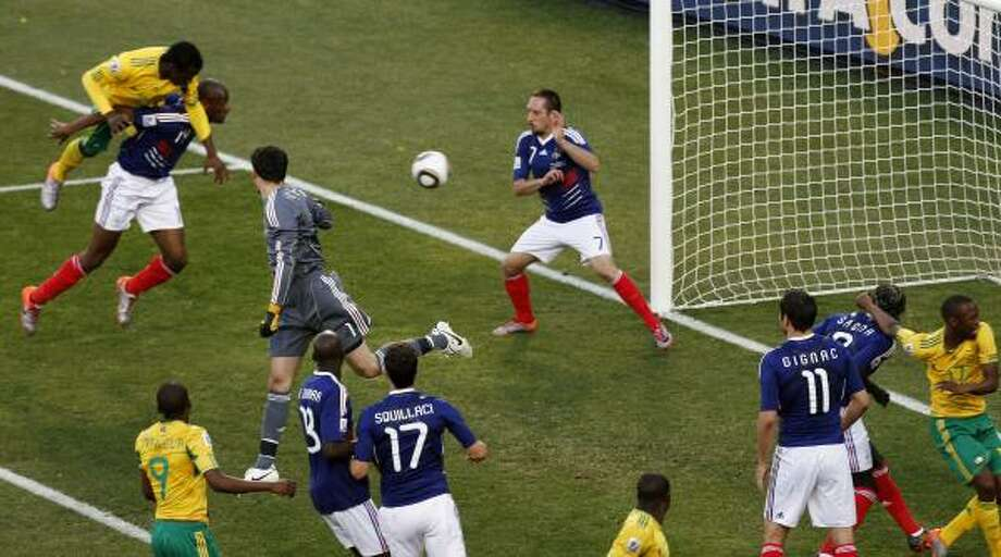 South Africa's Bongani Khumalo, top left, goes to score his team's first goal against France. Photo: Hassan Ammar, AP