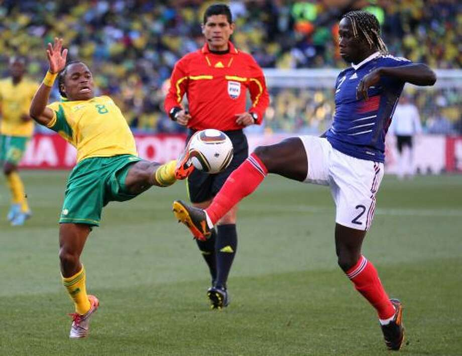 South Africa's Siphiwe Tshabalala, left, competes for the ball with France's Bacary Sagna. Photo: Themba Hadabe, AP