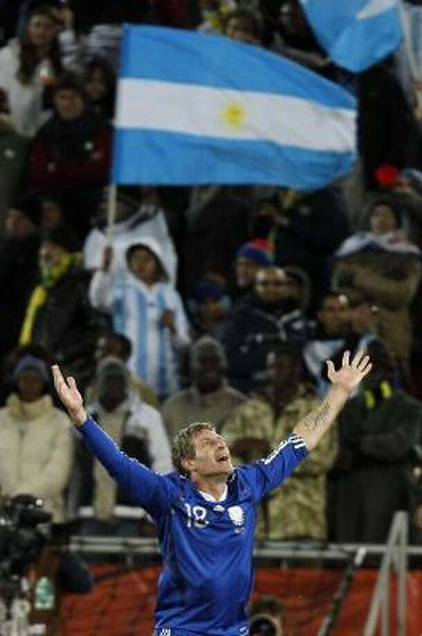 Argentina's Martin Palermo celebrates after scoring his team's second goal against Greece. Photo: Ricardo Mazalan, AP