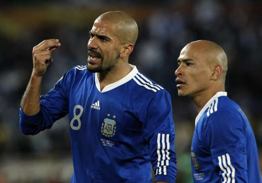 Argentina's Juan Sebastian Veron, left, and Clemente Rodriguez dispute a call. Photo: Bernat Armangue, AP