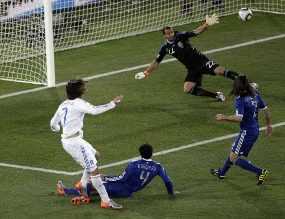 Greece's Georgios Samaras, left, misses a clear  scoring chance, shooting just wide of the far post. Photo: Michael Sohn, AP