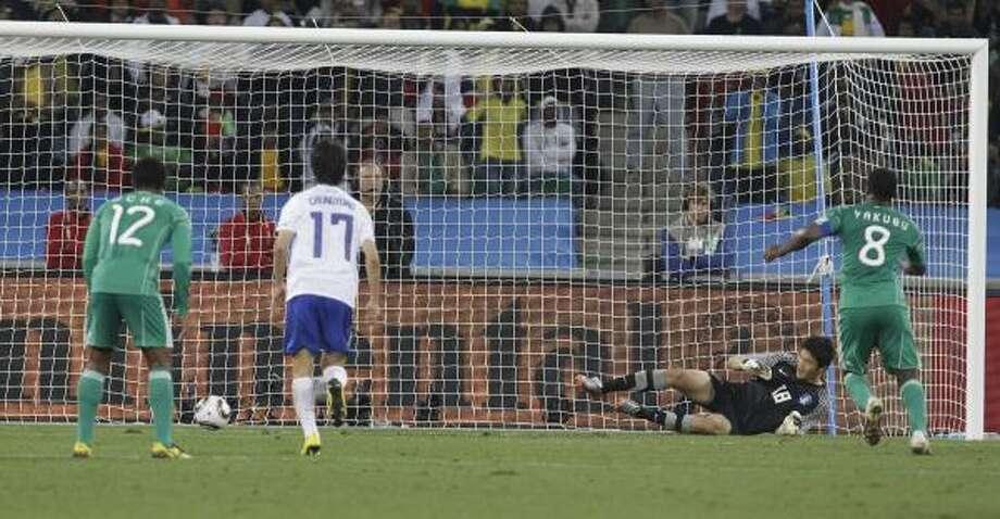 Nigeria's Yakubu Ayegbeni, right, scores on a penalty kick. Photo: Lee Jin-man, AP