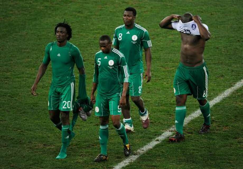 Dickson Etuhu, Rabiu Afolabi, Yakubu Ayegbeni and Danny Shittu of Nigeria are dejected after the draw eliminated them from the World Cup. Photo: Jamie McDonald, Getty Images