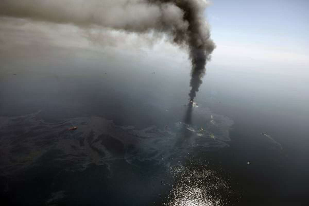 President Obama has called the oil spill in the Gulf of Mexico the worst environmental disaster in the history of the United States. The Washington Post asked historians whether that is accurate. Here, more than 50 miles southeast of Venice on Louisiana's tip, an oil slick is seen as the Deepwater Horizon oil rig burns April 21, 2010.