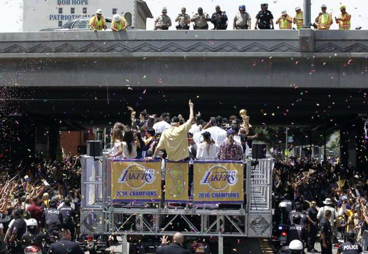 Fans cheer during the parade for the Los Angeles Lakers.