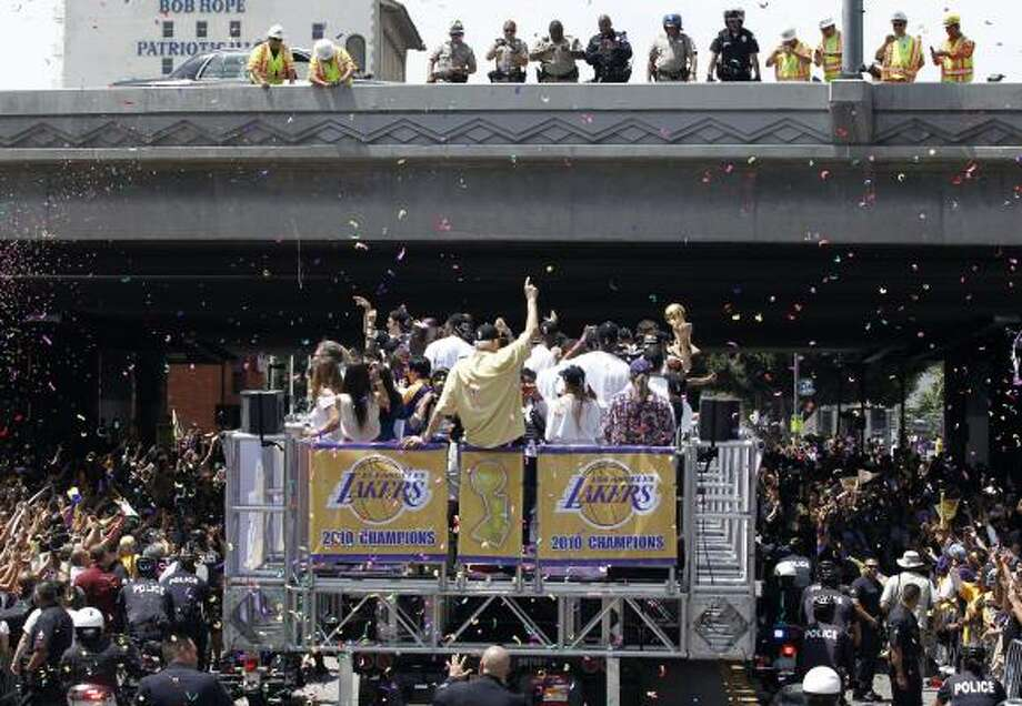 Fans cheer during the parade for the Los Angeles Lakers. Photo: Matt Sayles, AP