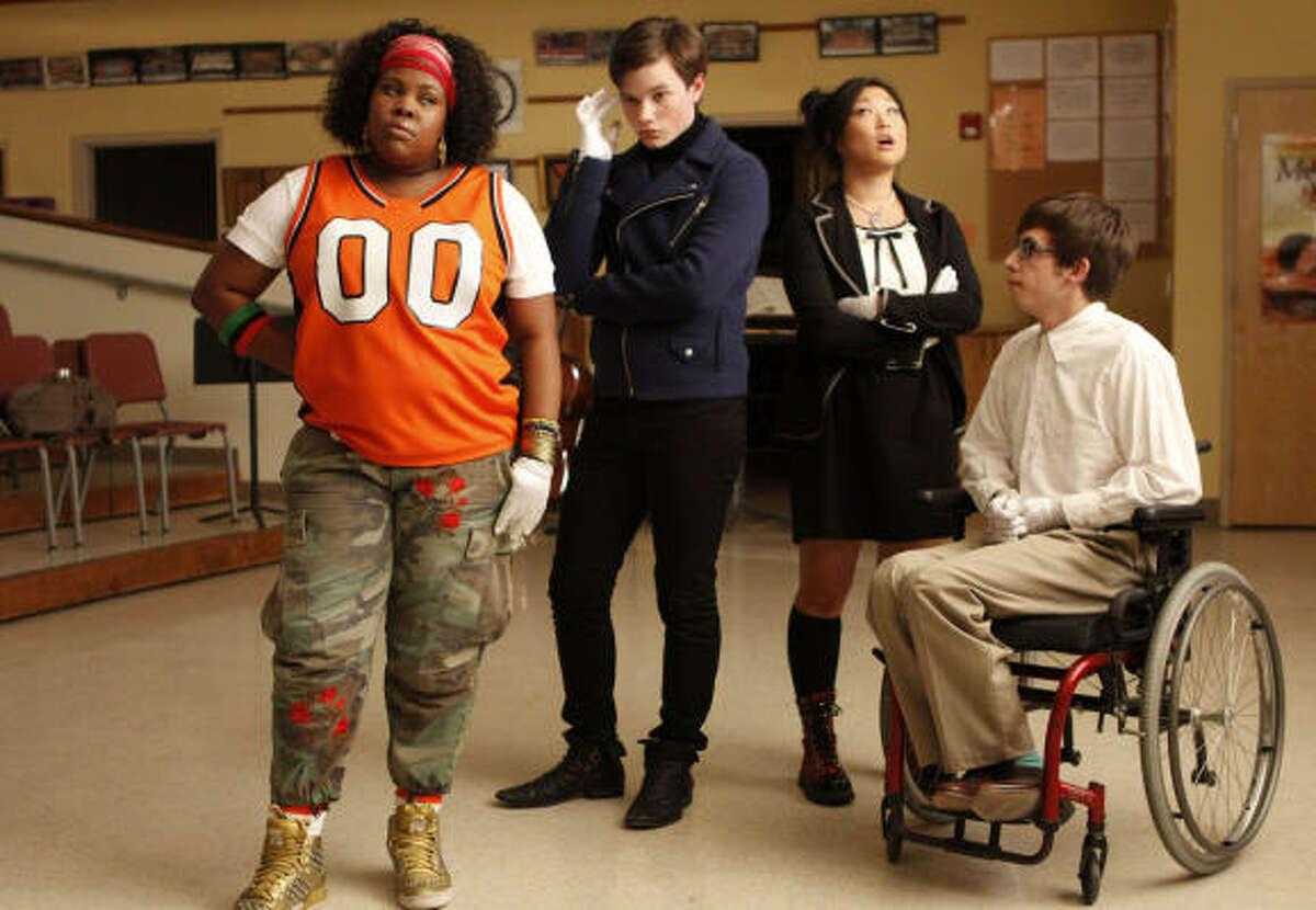 Kurt Hummel (second from left) on Glee