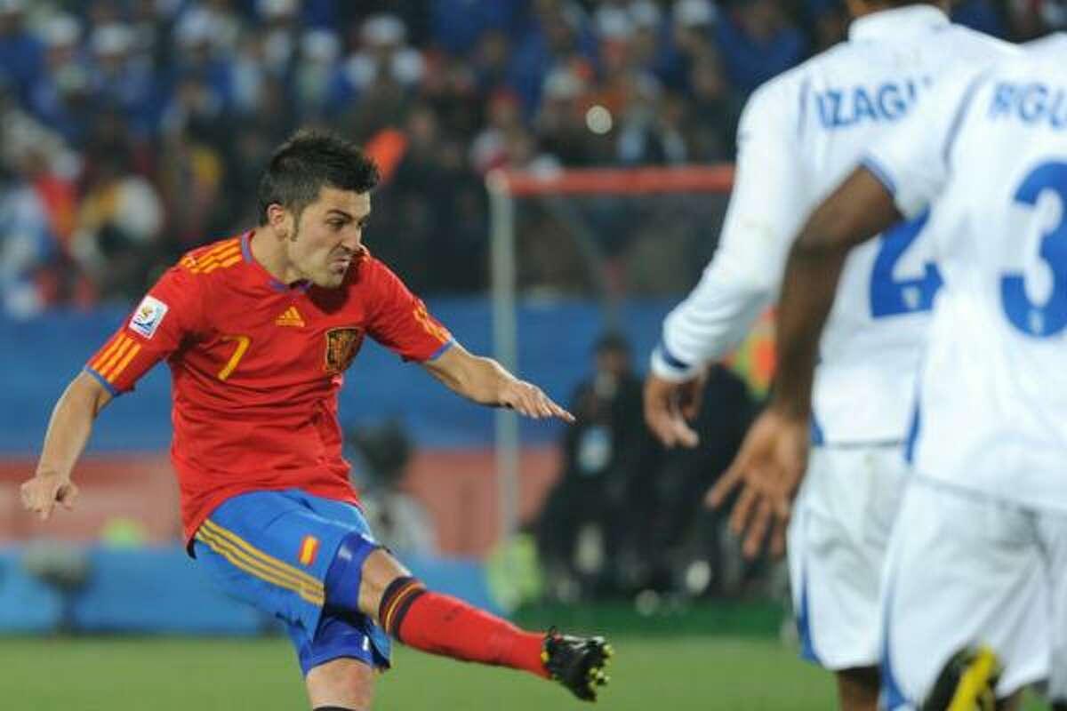 SPAIN 2, HONDURAS 0 Spain's David Villa shoots and scores against Honduras at Ellis Park Stadium in Johannesburg.
