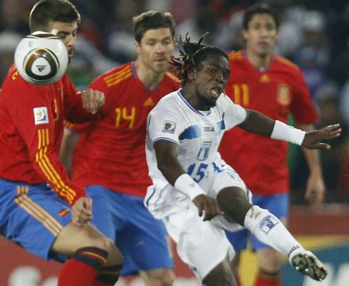 Honduras forward Walter Martinez, right, battles a swarm of Spain players.