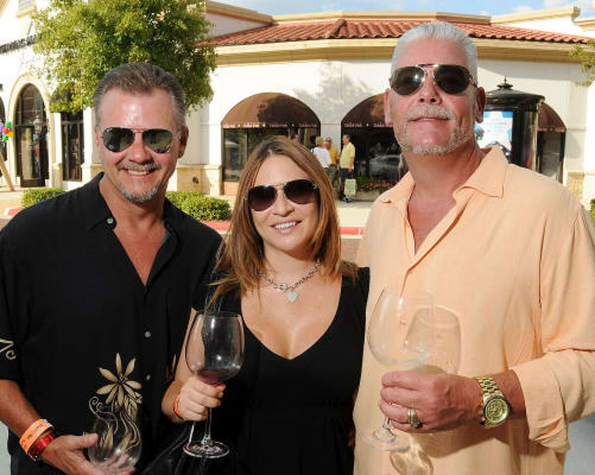 From left: Joe Russell, Gretchen Walton and Clint Sanders at the H-E-B Wine Walk at Market Street in The Woodlands.
