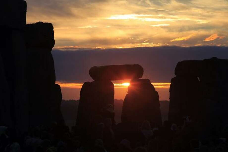 At Stonehenge, the sun rose at 4:52 a.m. on Monday, the summer solstice. Photo: Lefteris Pitarakis, AP