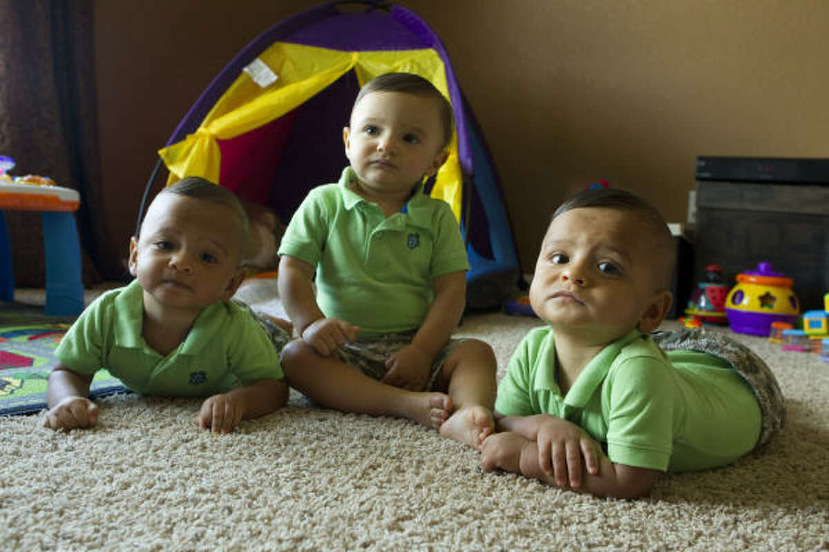 The Estrada brothers — Anthony, left, Robert and Brian