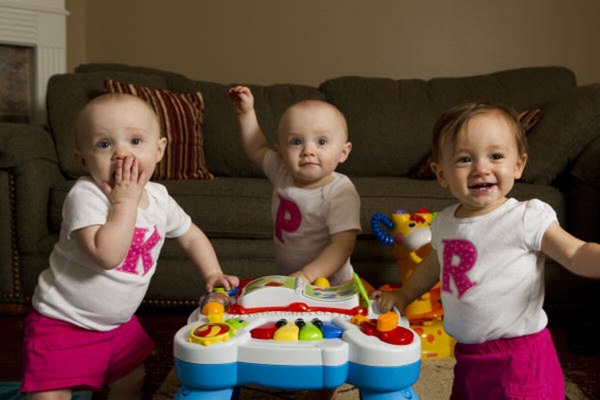 Kara, left, Paige and Reagan Elmore seem to love the camera.
