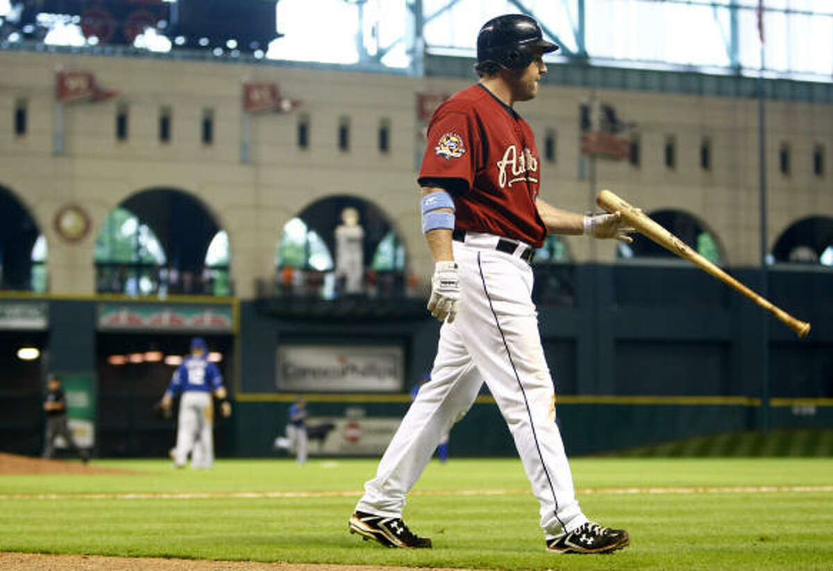 June 20: Rangers 5, Astros 4 (10) Lance Berkman walks back to the dugout after he struck out to end the game in the 10th inning.