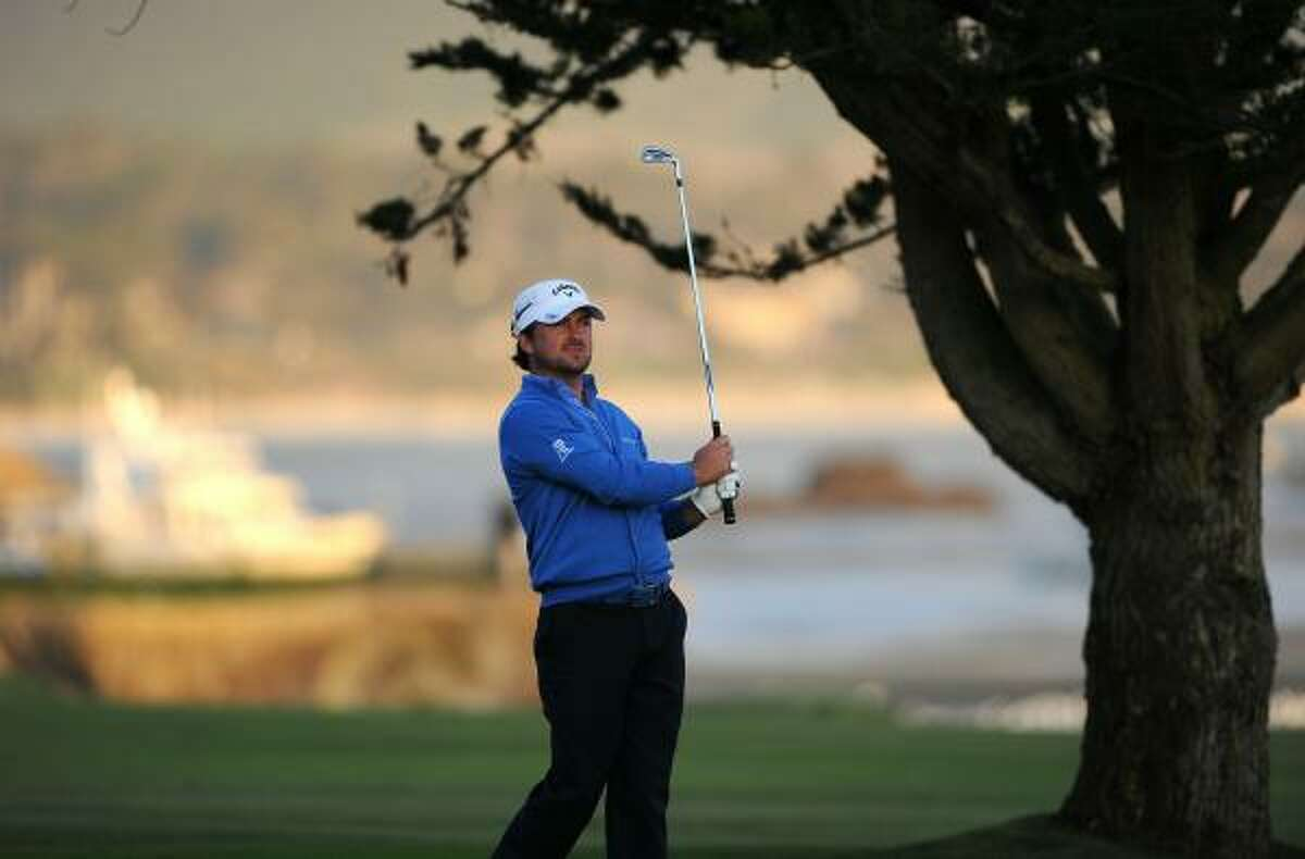 Northern Ireland's Graeme McDowell trails Dustin Johnson by three shots after three rounds.