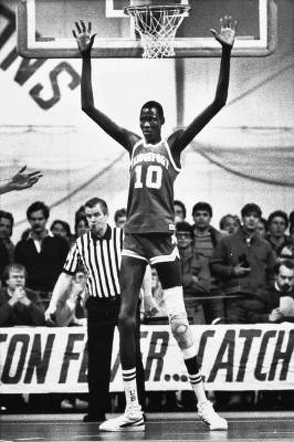 Manute Bol defends the basket for the University of Bridgeport on Jan. 11, 1985. A few months later, he was picked up by the Washington Bullets as the 32nd pick in that year's NBA draft.