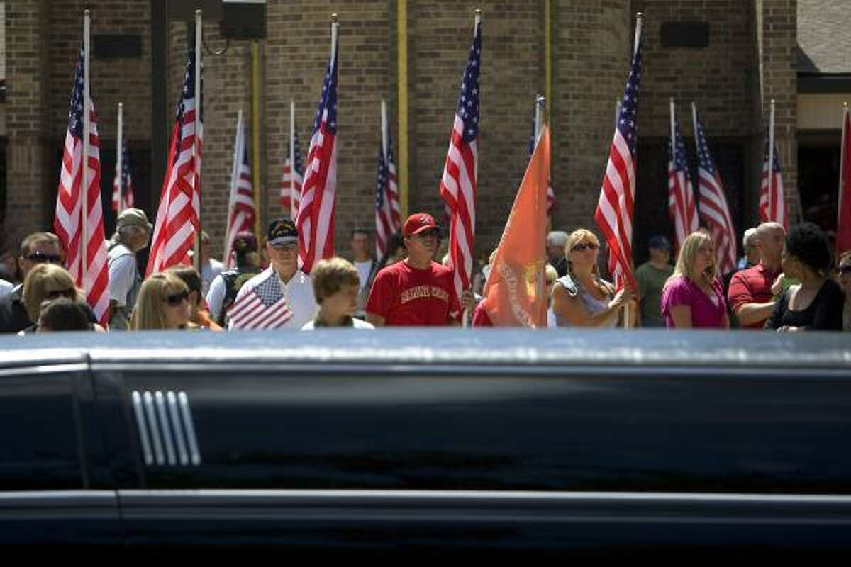 Loved ones and members of the Patriot Guard Riders honor Bury's family.