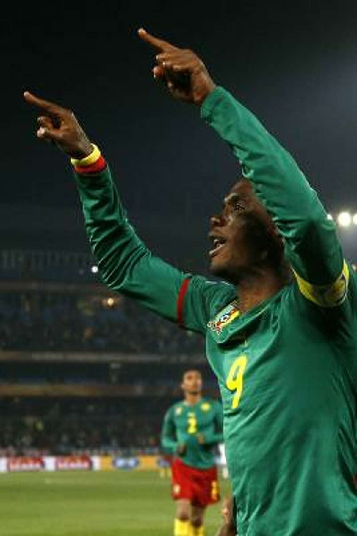 Cameroon's striker Samuel Eto'o celebrates after scoring the opening goal during the Group E first round 2010 World Cup football match Cameroon vs. Denmark on June 19, 2010 at Loftus Verfeld stadium in Tshwane/Pretoria. NO PUSH TO MOBILE / MOBILE USE SOLELY WITHIN EDITORIAL ARTICLE - AFP PHOTO / THOMAS COEX (Photo credit should read THOMAS COEX/AFP/Getty Images)