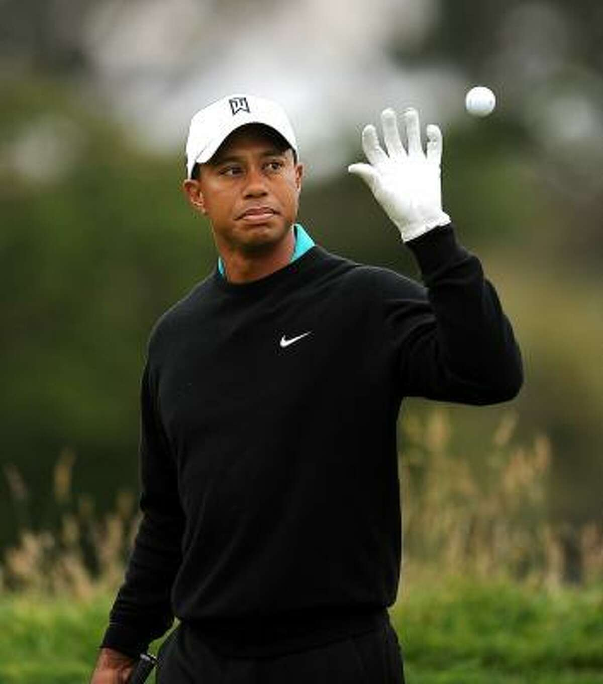 Tiger Woods shot a 1-over 72 in the second round to finish seven shots behind leader Graeme McDowell of Northern Ireland.