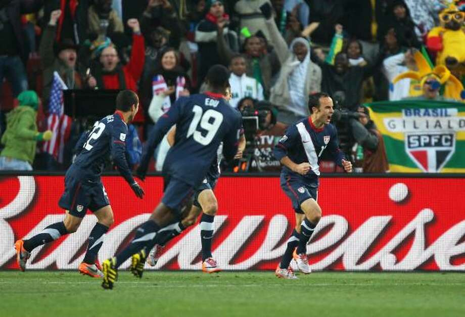 UNITED STATES 2, SLOVENIA 2 Landon Donovan of the United States celebrates with teammates after scoring his team's first goal at Ellis Park Stadium in Johannesburg. Photo: Streeter Lecka, Getty Images