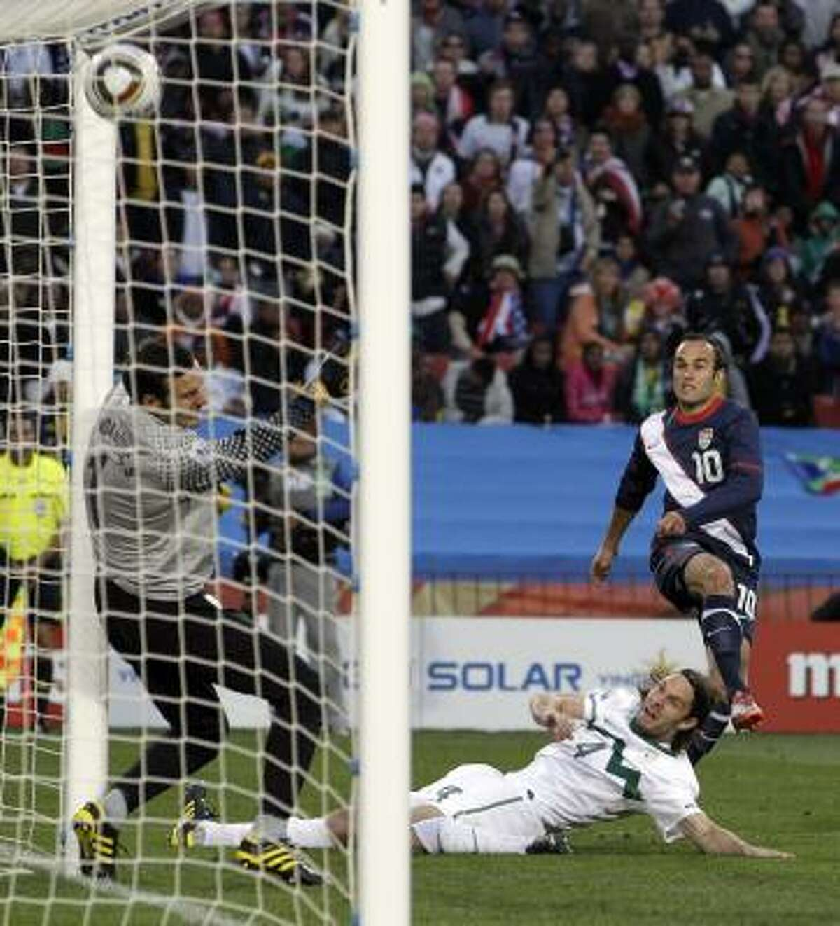 Landon Donovan, top right, scores three minutes into the second half to get the U.S. on the board.