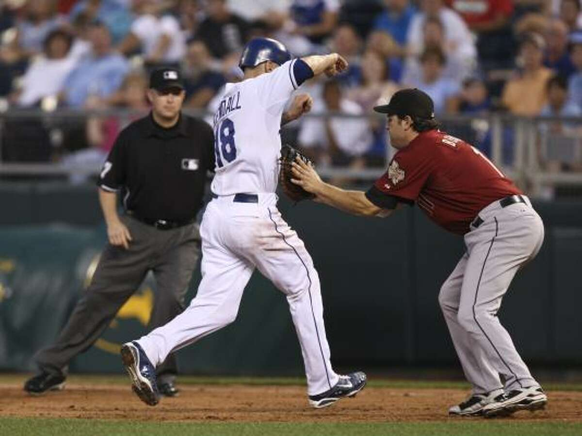 Royals' Jason Kendall is caught stealing second in a run down by Astros first baseman Lance Berkman.