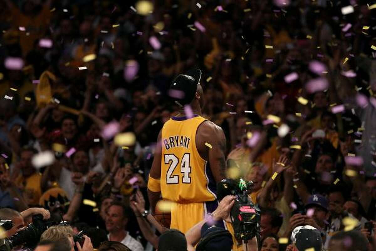 Game 7: Lakers 83, Celtics 79 Lakers guard Kobe Bryant celebrates after winning his fifth NBA title and second Finals MVP award as the Lakers defeated the Celtics 83-79 in Game 7.