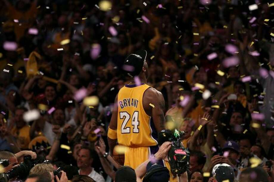 Game 7: Lakers 83, Celtics 79 Lakers guard Kobe Bryant celebrates after winning his fifth NBA title and second Finals MVP award as the Lakers defeated the Celtics 83-79 in Game 7. Photo: Christian Petersen, Getty Images