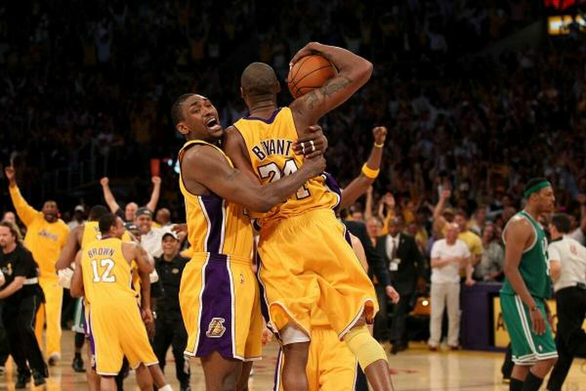 Lakers forward Ron Artest (37) and guard Kobe Bryant (24) celebrate as the Lakers defeated the Celtics in Game 7 to win the 2010 NBA Finals.